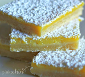 Lemon Bars stacked and topped with powdered sugar.