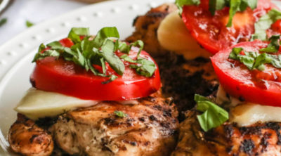 Caprese Chicken served on a white dish.