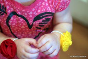 Toddler Fabric Flower Bracelets on toddler wrists