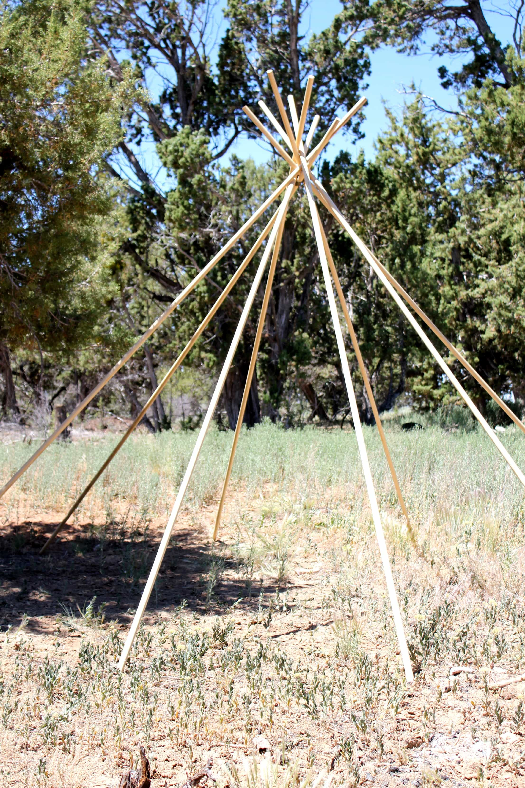 Easy DIY No Sew Burlap TeePee adding the poles