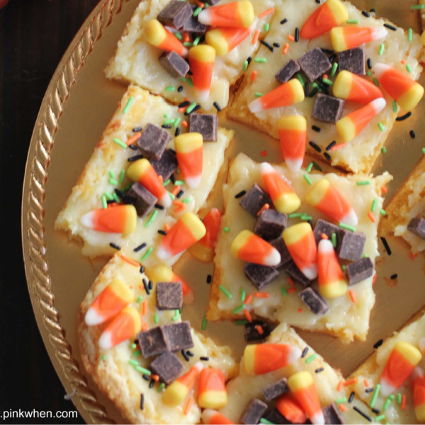 Candy corn cheesecake bars on a plate ready to serve.