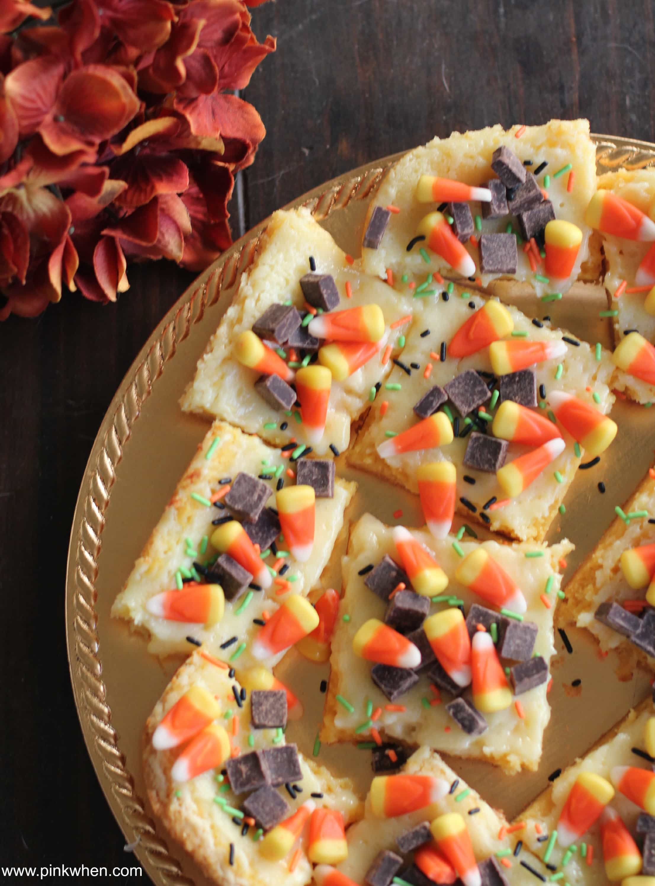 Fall Inspired Ooey Gooey Cake Mix Cheesecake Bars via PinkWhen.com 2
