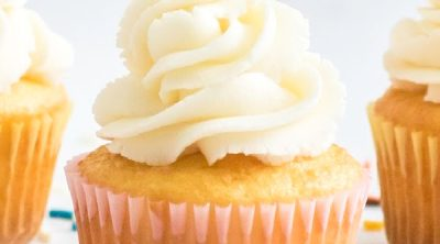 Fresh old fashioned vanilla buttercream frosting on a cupcake.