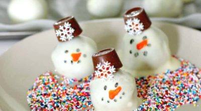 OREO Snowman Cookie balls on a white plate.