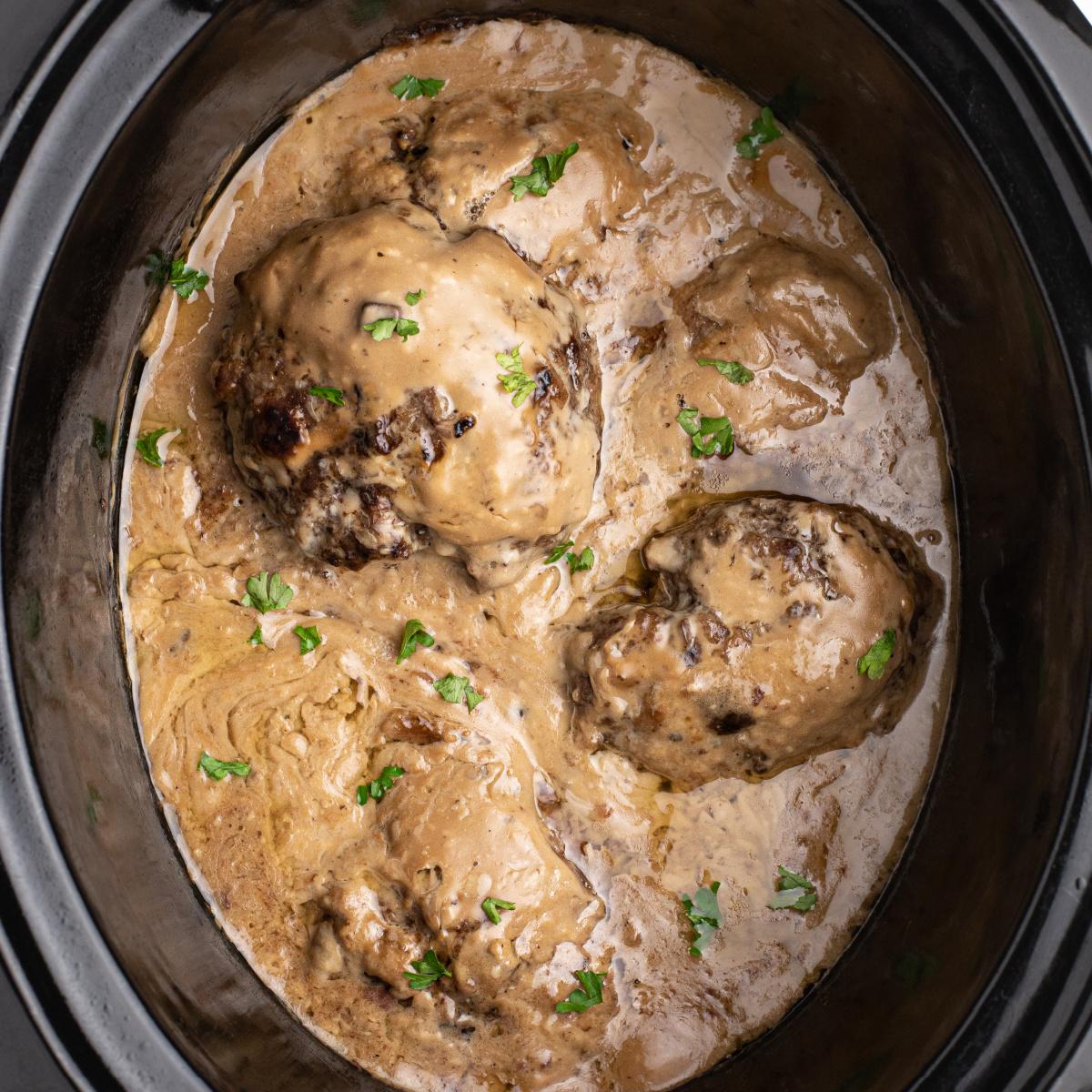 Slow Cooker Salisbury Steak in the liner of a Crock pot.