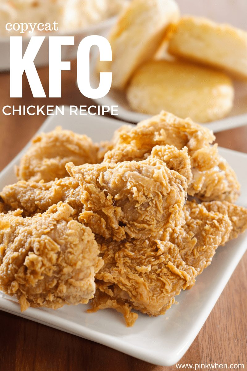 Copycat KFC Chicken in a bowl with a plate of biscuits in the background.