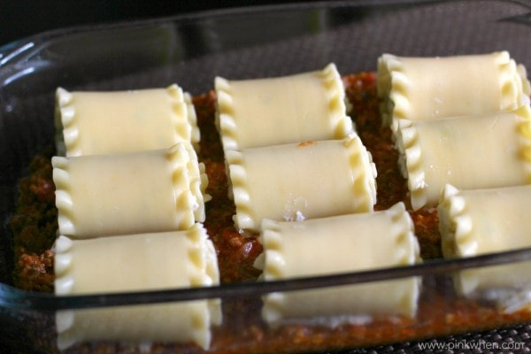Lasagna Rolls placed onto meat mixture.