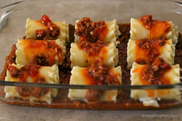 Lasagna Rolls covered in meat sauce.