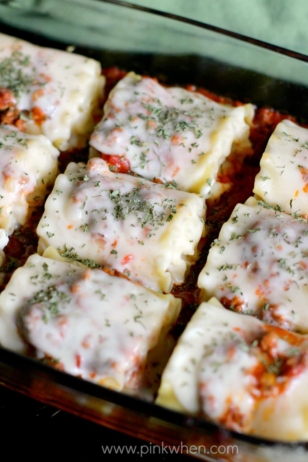 Fully cooked lasagna rolls in a baking dish.