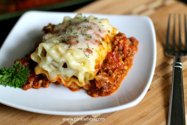 Lasagna roll on a white plate.