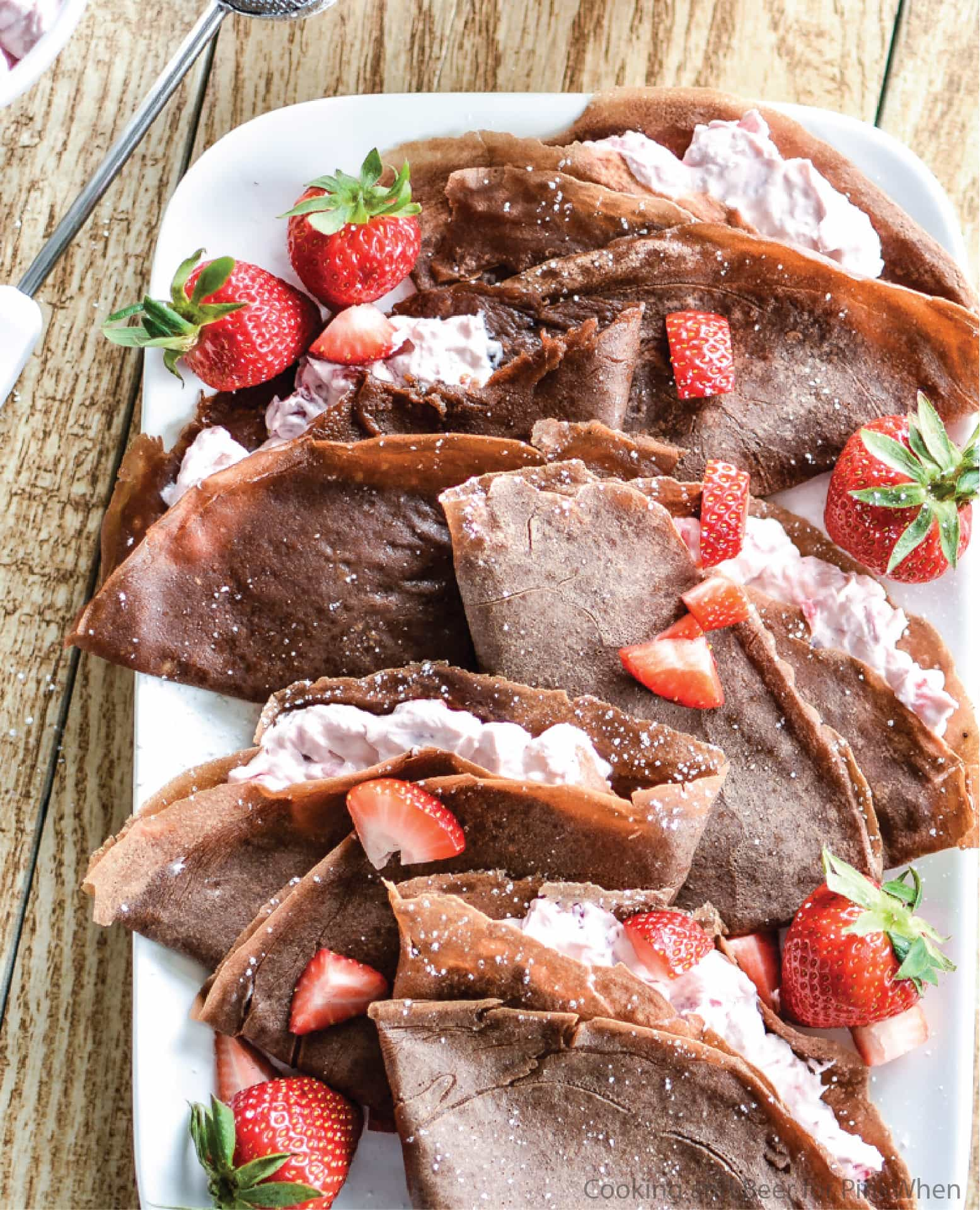 Strawberry Cheesecake Chocolate Crepes served on a white dish.