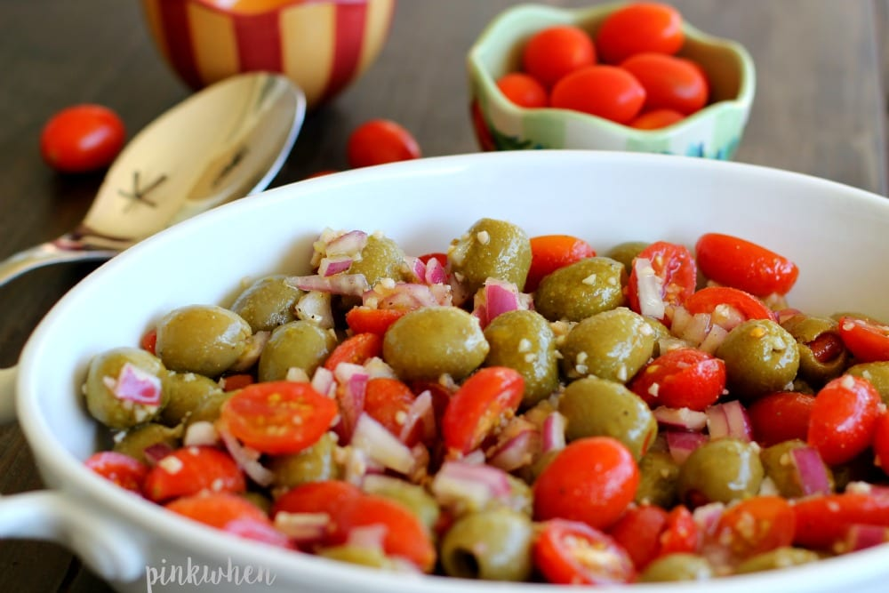 Marinated Olive and Grape Tomato Salad in a white dish.