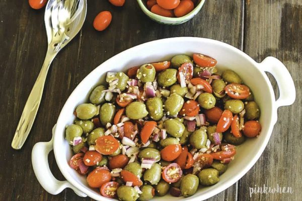 Tomato Salad with Olives topped with parmesan cheese.