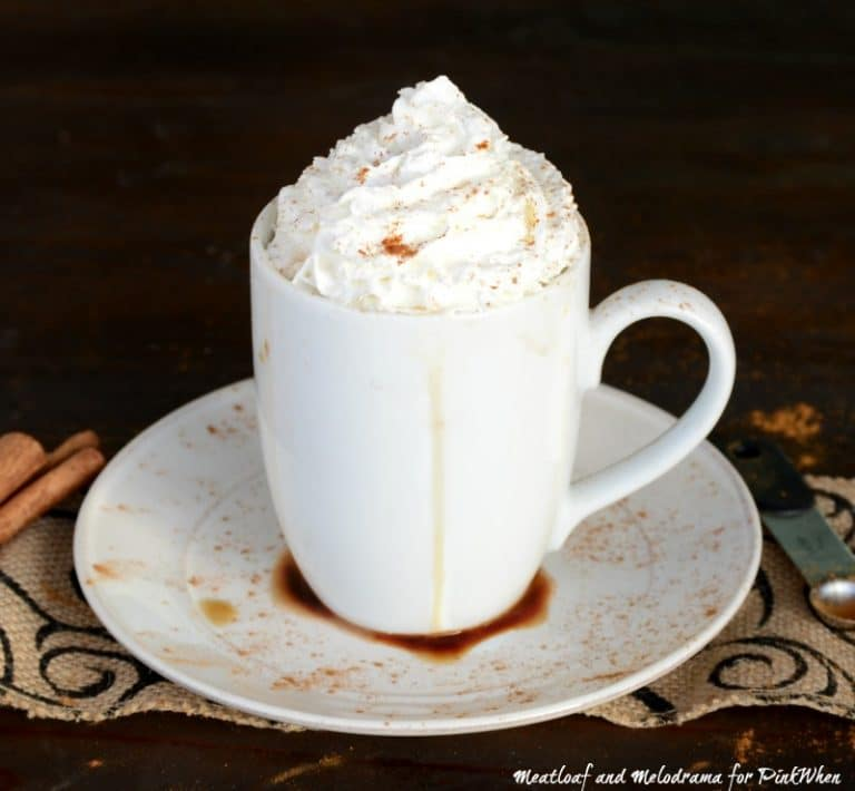 This creamy Cinnamon Vanilla Hot Chocolate topped with whipped cream is the perfect drink to warm you up on those cold, winter nights. #hotchocolate #vanillahotchocolate