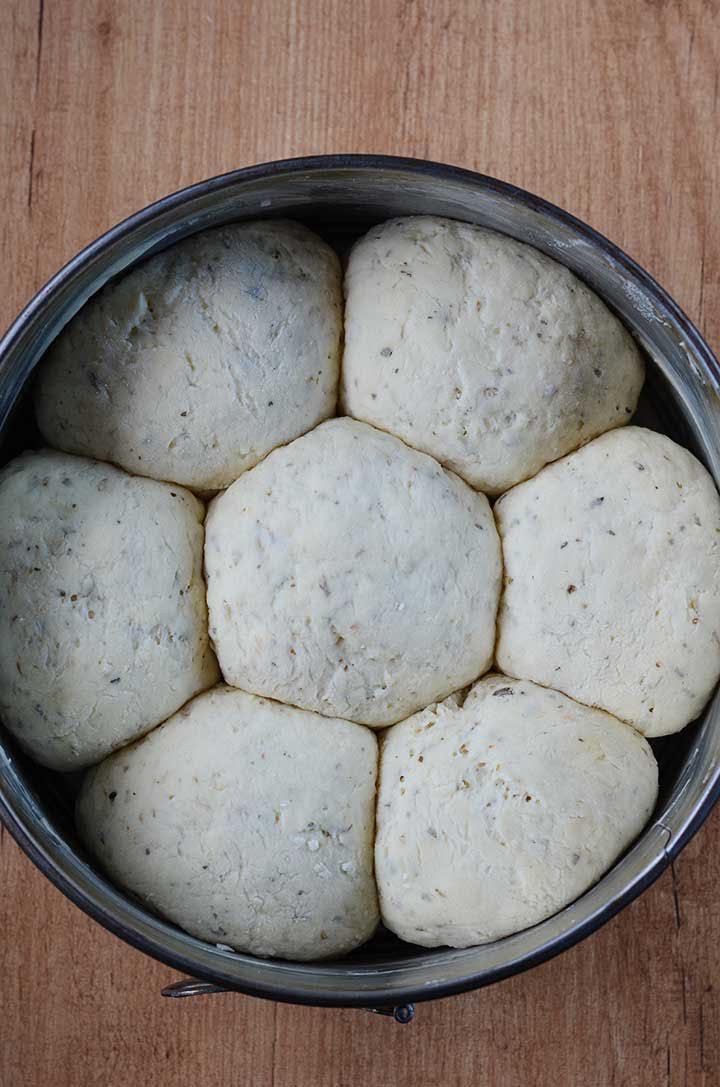 This gluten free garlic herb dinner rolls recipe is bursting with flavor! They're crusty on the outside, soft and fluffy on the inside.