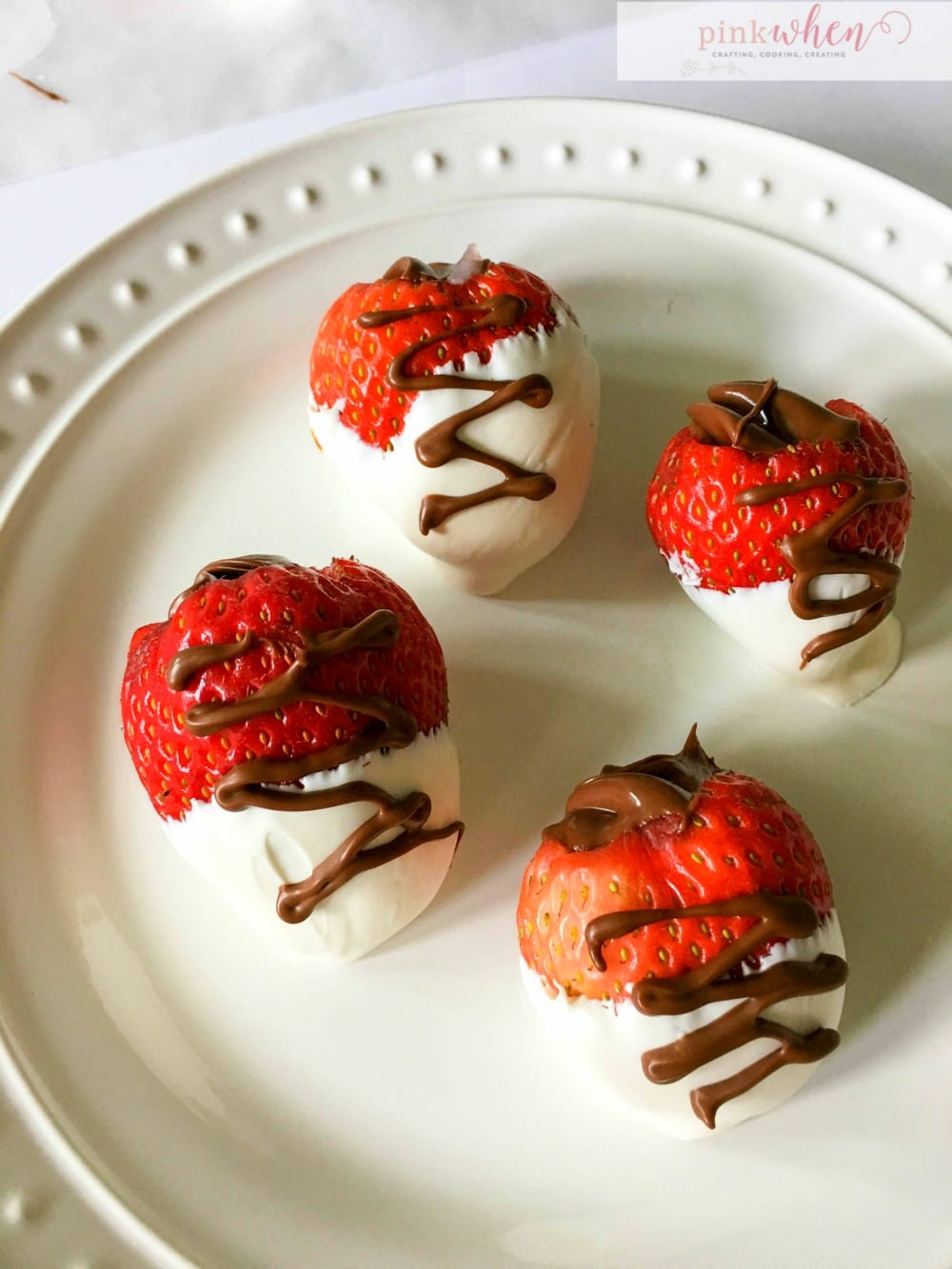 I love Nutella, and I love chocolate covered strawberries, so when you mash these two together, you get a DELICIOUS nutella stuffed chocolate covered strawberry treat.