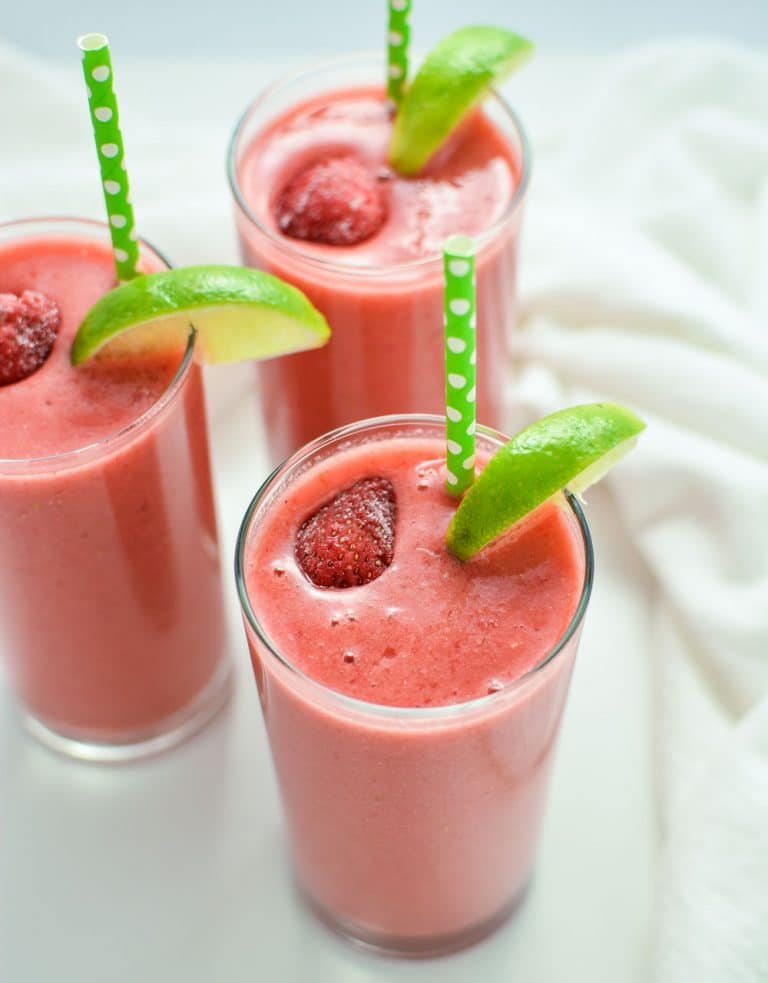 Triple Berry Limeade Smoothies made with almond milk, mixed berries, banana, and flax seed. A perfect breakfast smoothie!