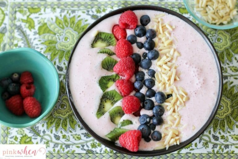 A Berry-licious smoothie bowl recipe made with strawberries, almonds, greek yogurt, organic milk, kiwi, blueberries, and raspberries. All with the daily recommended protein for breakfast of 25-30 grams!