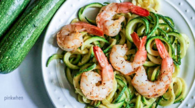 Shrimp scampi zoodles on a white plate