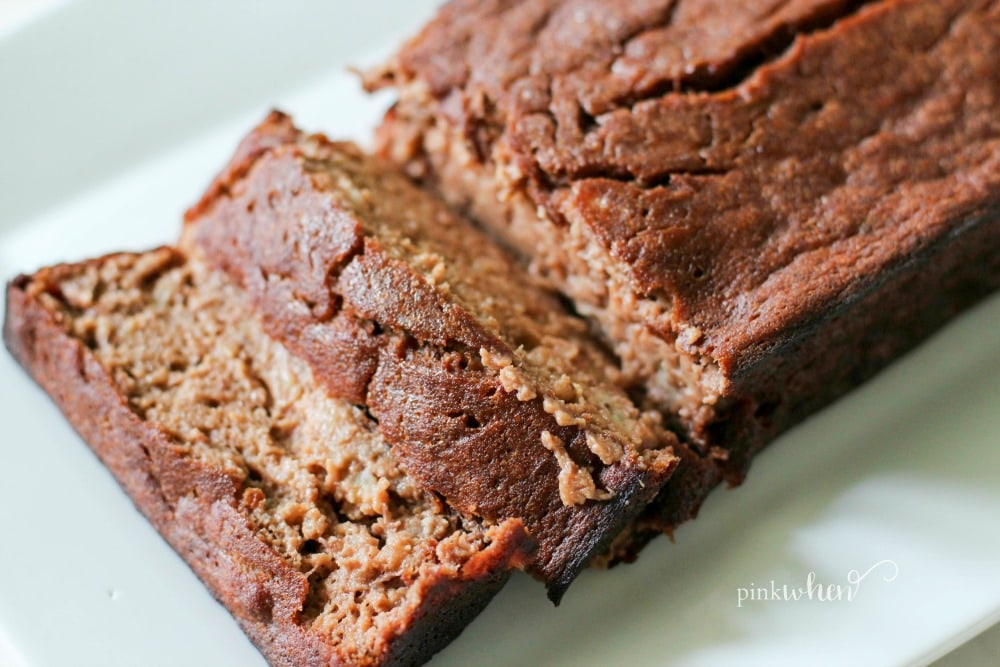 This skinny chocolate banana bread recipe is on a white serving dish.