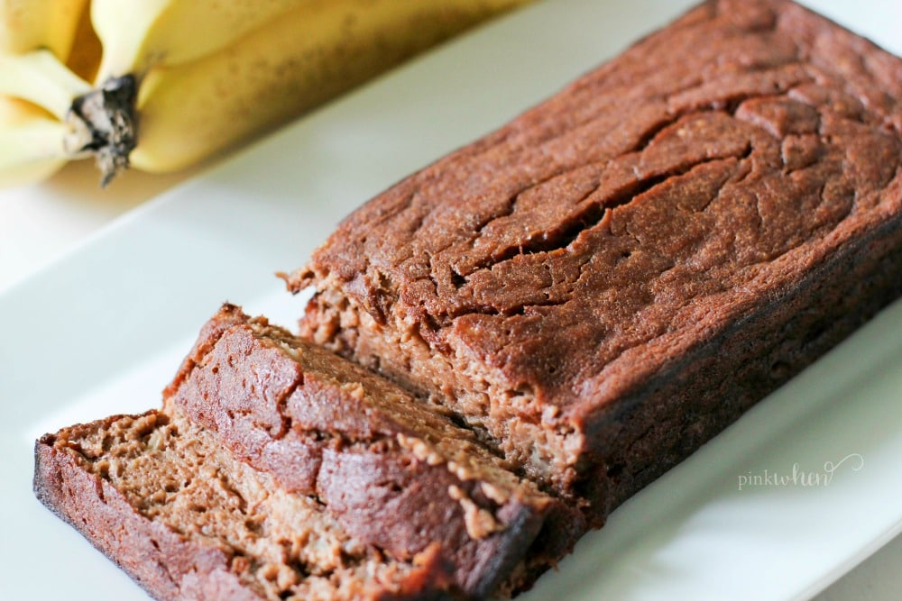 chocolate banana bread on a white serving dish