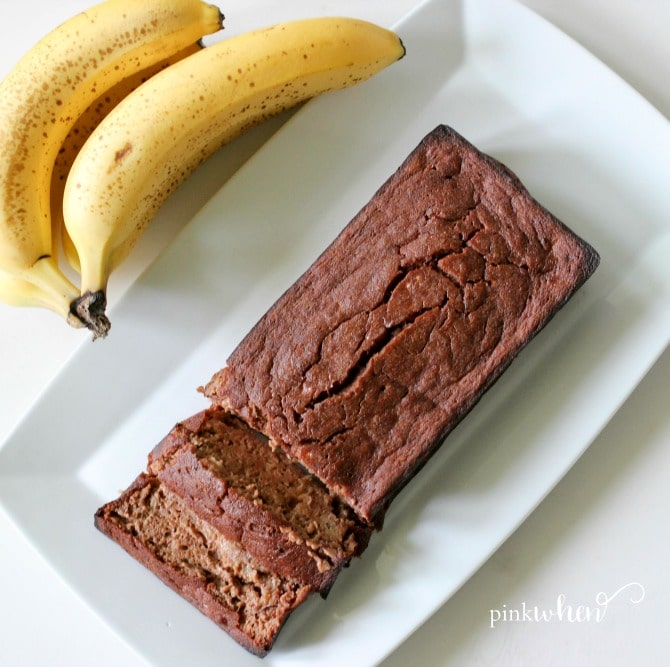 This skinny chocolate banana bread recipe is on a serving dish and sliced.