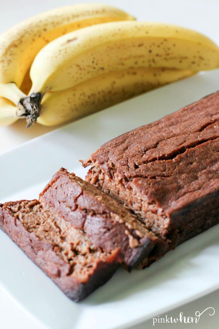 This skinny chocolate banana bread recipe is on a white serving tray.