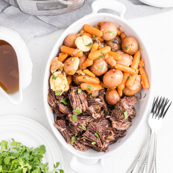 Instant Pot Pot Roast in a dish and ready to serve.