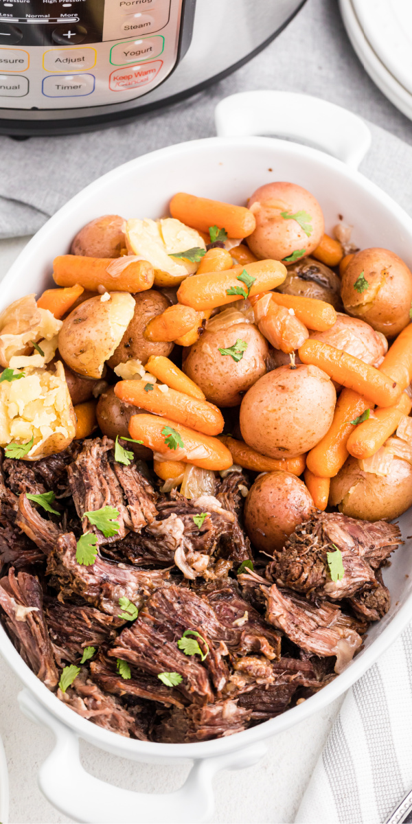 Family-Approved! Take the guesswork out of dinner with this quick and easy Pot Roast made in the pressure cooker. Made with roast, carrots, potatoes, and more. It's the perfect hearty meal the whole family will love.