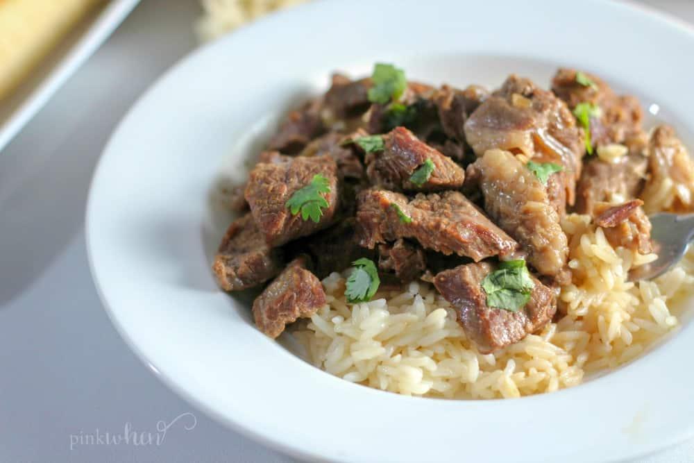 fully cooked Instant Pot beef tips over rice