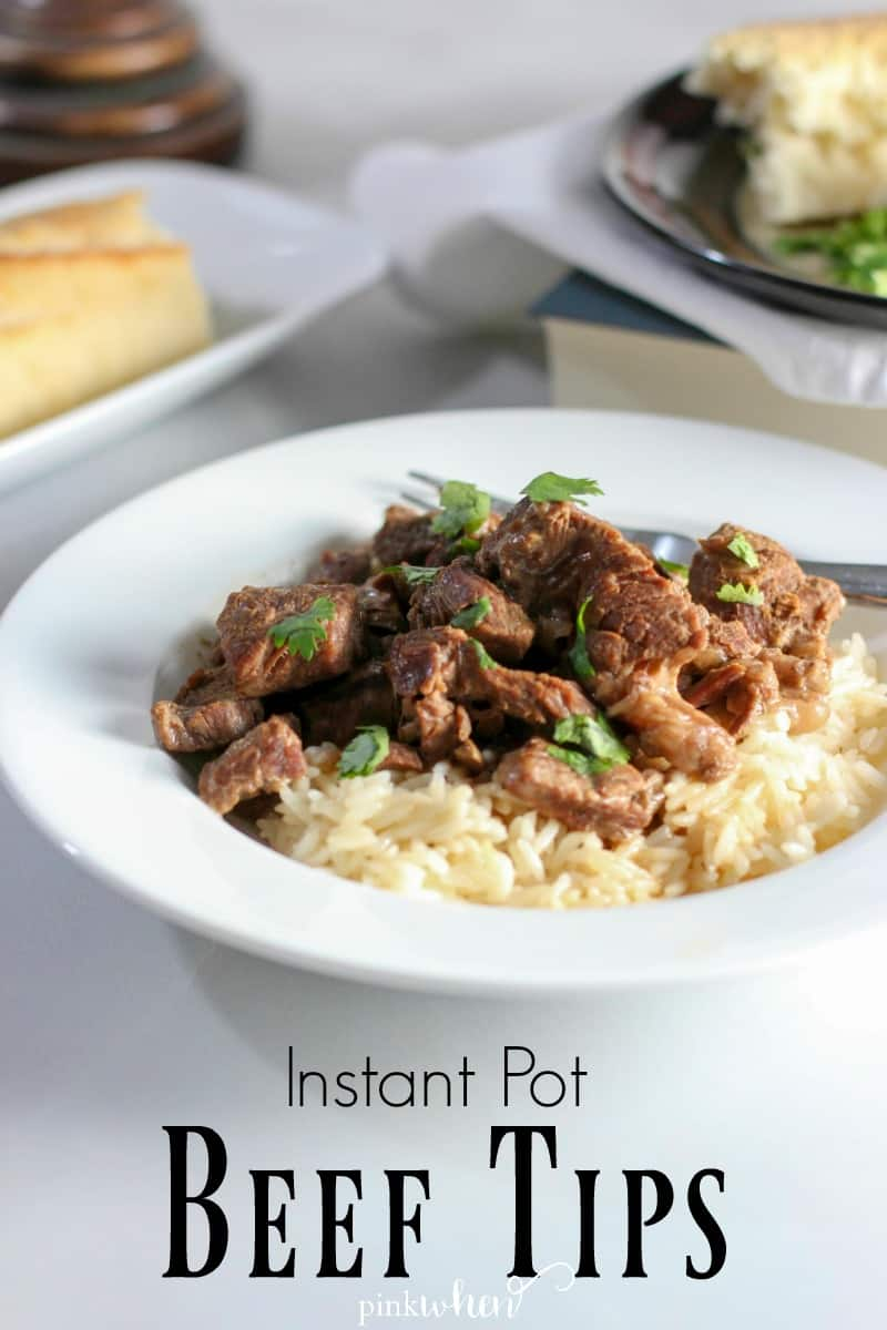 Instant Pot Beef Tips and rice in a white bowl on a light table.