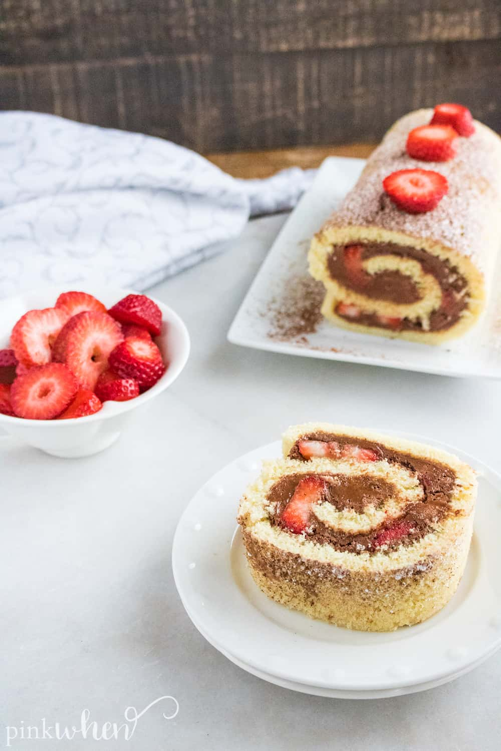 This is one of our new favorite dessert recipes - full of delicious chocolate strawberry flavor! This chocolate ganache cake roll recipe is so sweet, spongey, moist, and delicious! This chocolate roll cake will easily become a favorite in your household!