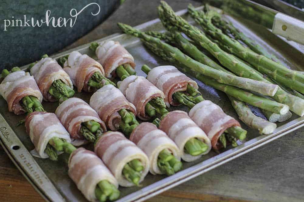 Quick and easy bacon wrapped asparagus. The perfect addition to any menu for the grill. #bacon #asparagus #sidedish #grilledrecipe