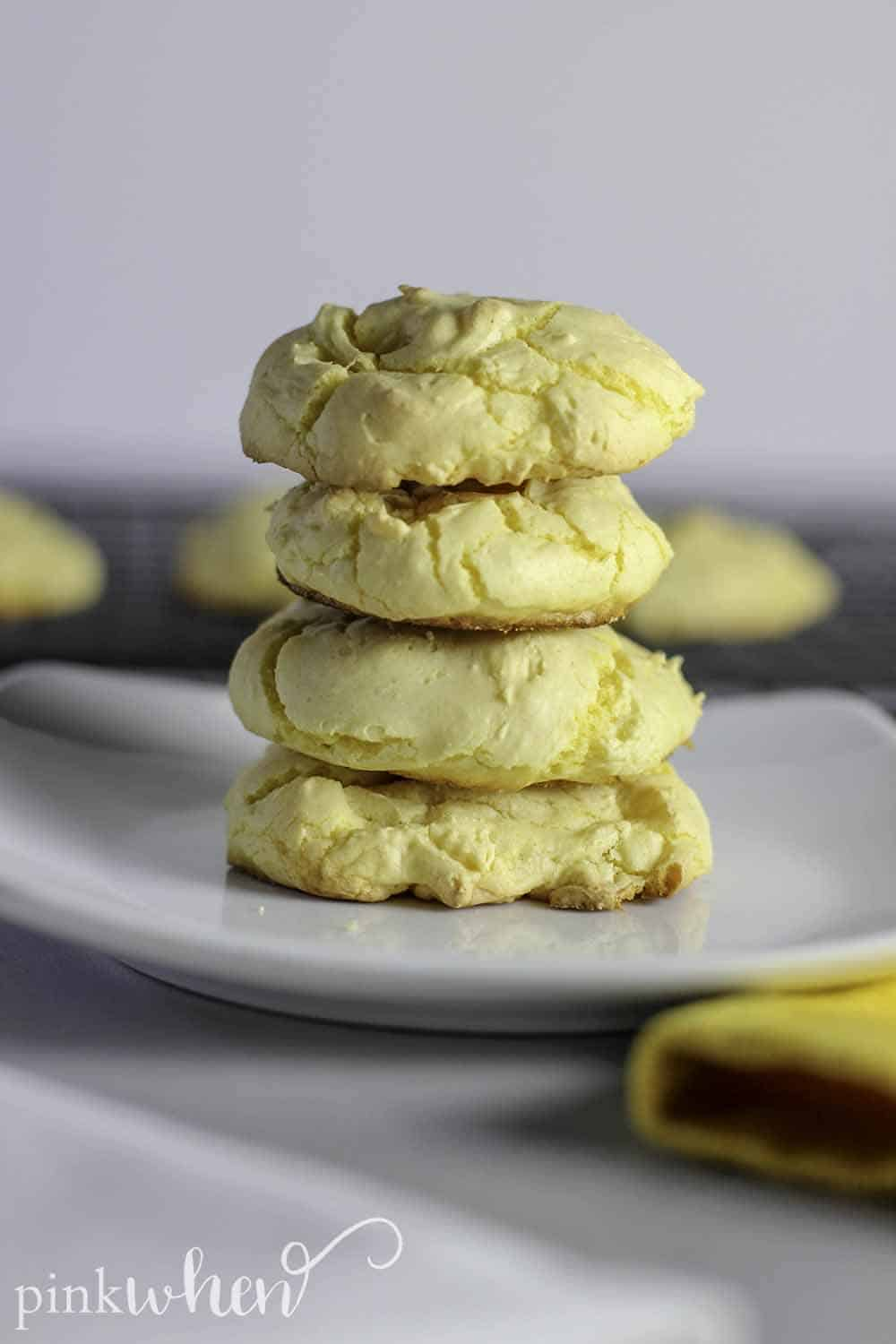 Fluffy Lemon Cake Mix Cookies stacked vertically on a white dish.