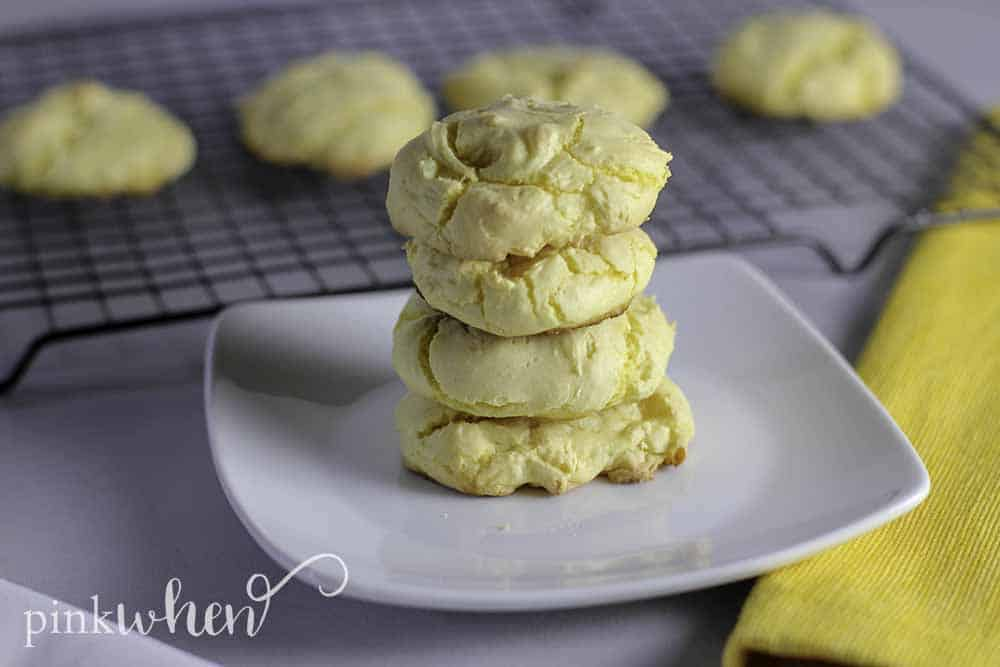 Lemon Cake Mix Cookies stacked on a white plate.