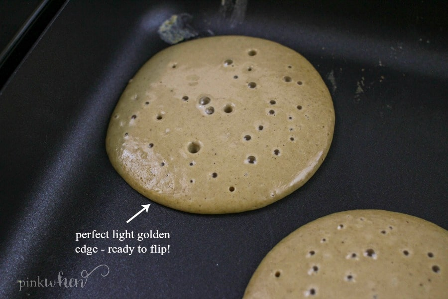 Protein pancakes cooking on a griddle.