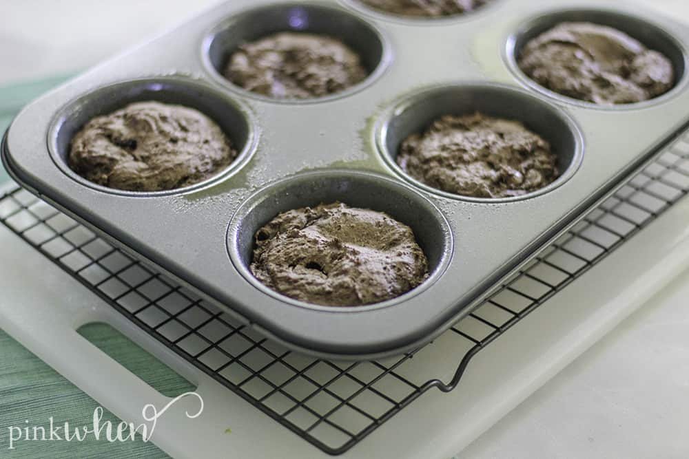 4 Ingredient Double Chocolate Chip Muffin Recipe. These taste like the best brownies EVER. Serve warm with some vanilla ice cream and YUM... #chococlatechipmuffins #dessert