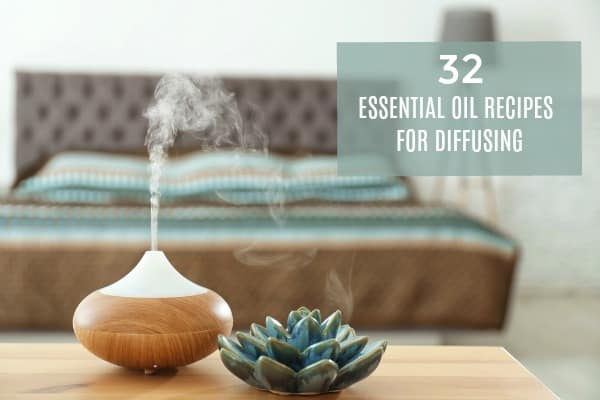 essential oil diffuser that is diffusing oils in a bedroom on a table.