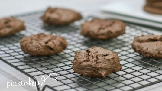 Chocolate cake mix cookies cooling on a rack.