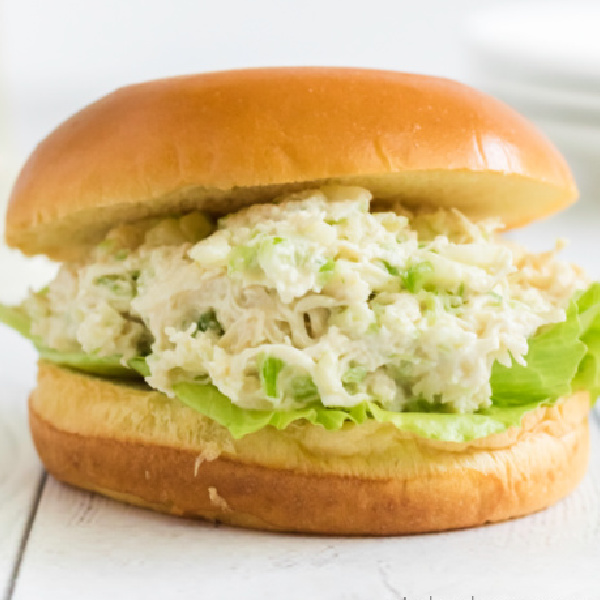 Chicken salad on a bun and ready to eat.