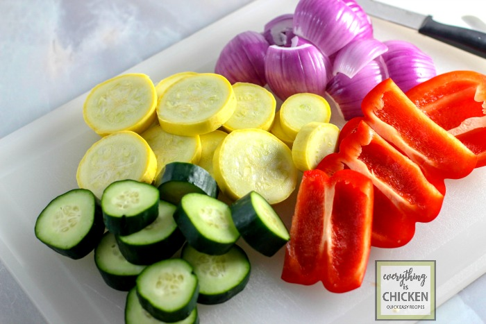 Mixed vegetables on a white cutting board.