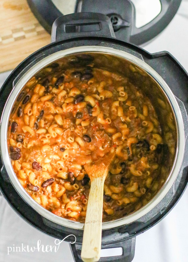 Chili Mac in the Instant Pot with wooden spoon.