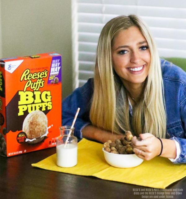 Girl eating Reese's Puffs Big Puffs cereal.