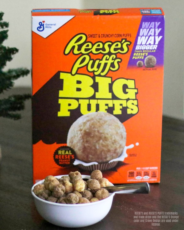 Reese's Puffs Big Puffs cereal in a bowl with box of cereal behind it.