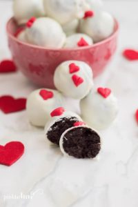 OREO Truffles in a dish with scattered red hearts.