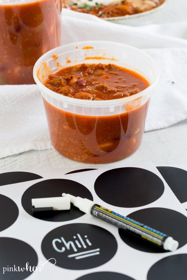 chili in a storage container for freezing with labels.