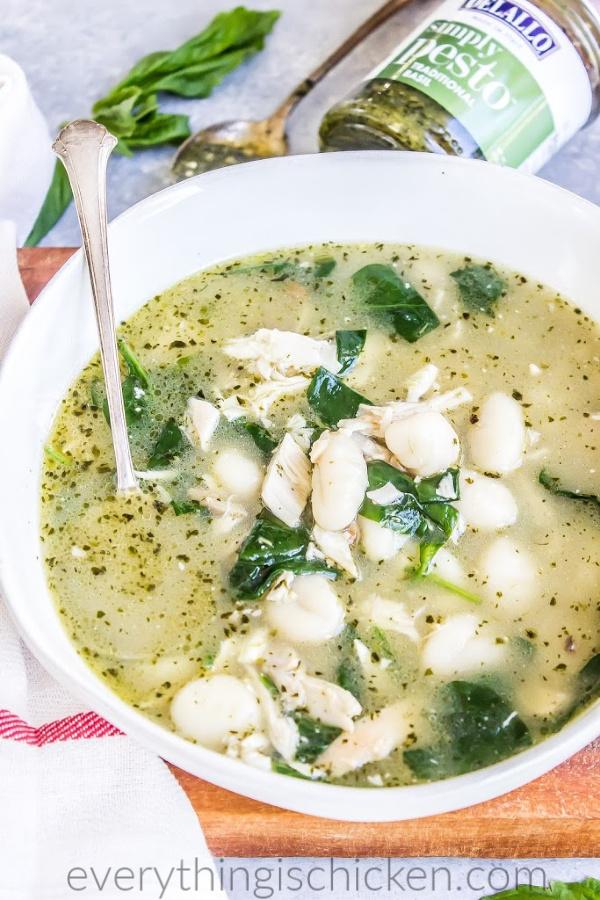 chicken gnocchi soup in a white dish.