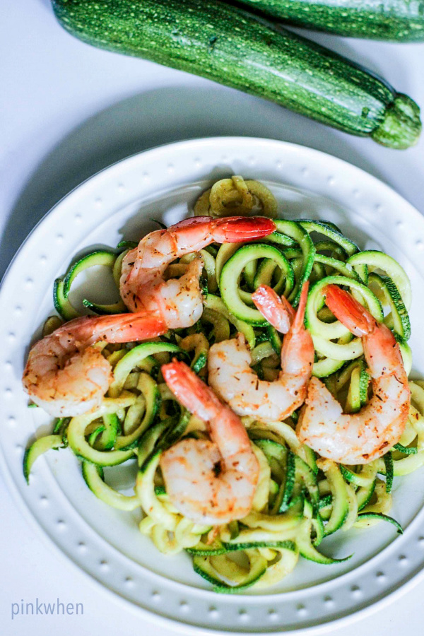 shrimp scampi and zucchini noodles on a white plate