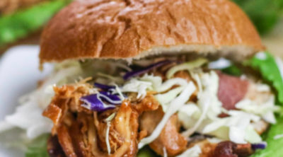 Slow Cooker BBQ Chicken served on a bun.