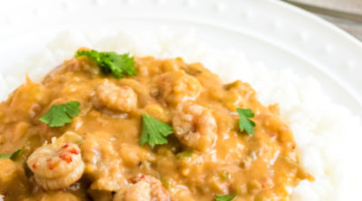 Crawfish Etouffee Recipe in a bowl of rice.